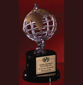 Gold and Silver Metal Globe on a Black Crystal Base